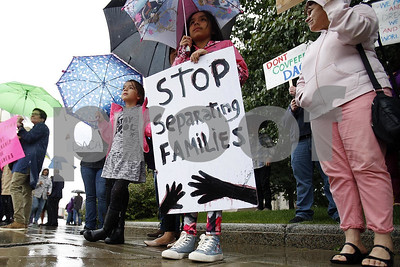 in-this-sept-7-2017-file-photo-april-soasti-9-front-and-her-sister-adriana-7-stand-with-other-community-members-after-the-president-announced-the-plan-to-repeal-of-the-deferred-action-in-chi