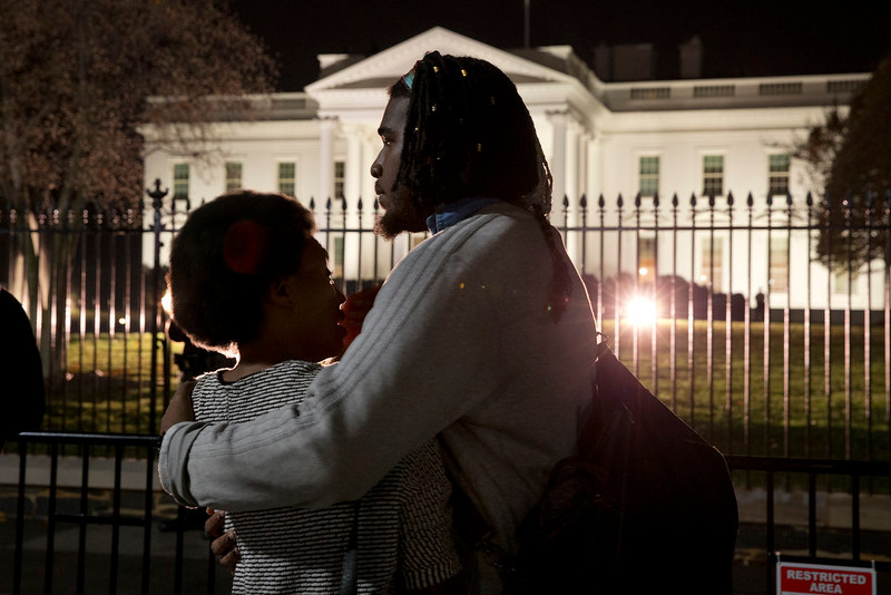 ". Bonnie Mills, 19, left, a junior at Howard University, is hugged by a friend, who asked not to be named, as they gather with students from Howard University and others in front of the White House Monday, Nov. 24, 2014, in Washington, in reaction to the Ferguson grand jury decision not to indict police officer Darren Wilson in the shooting death of Michael Brown. ""We were sitting in the student lounge waiting for the verdict,\"" says Mills, \""and the fact that he won\'t even go to trial really affected us.\"" (AP Photo/Jacquelyn Martin)"