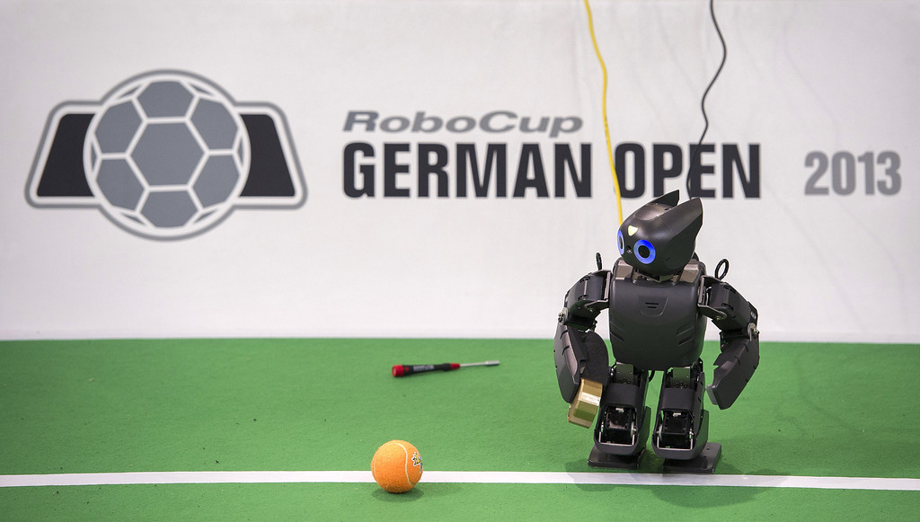 . MAGDEBURG, GERMANY - APRIL 26:  A robot in the play field at the 2013 RoboCup German Open tournament on April 26, 2013 in Magdeburg, Germany. The robots, which are a model called Nao, manufactured by Aldebaran Robotics, perform autonomously and communicate with one another via WLAN. The three-day tournament is hosting 43 international teams and 158 German junior teams that compete in a variety of disciplines, including soccer, rescue and dance.  (Photo by Jens Schlueter/Getty Images)