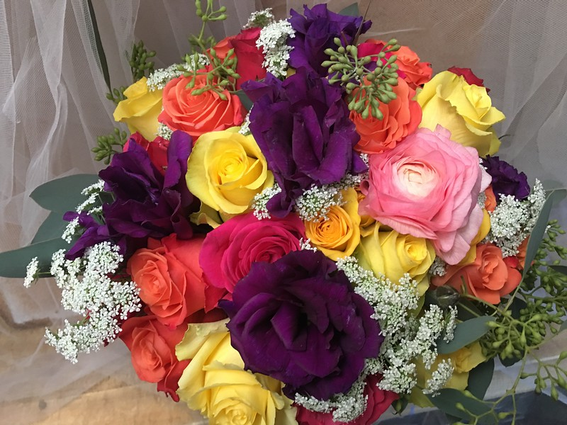 Mexican fiesta! purple lisianthks, pink ranunculus,  mix of rose colors $135
