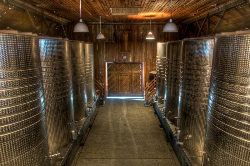 Frogs Leap Winery rebuilt this very old barn (piece by piece they took it apart, fixed it up, and then rebuilt it using the exact same pieces of wood in the exact same spots). Now they do all of their barrelling in here and you can see the stainless steel tanks. I love how there's that contrast between steel and wood in the background.  I liked the original shot (non-HDR) version better, but I couldn't help enjoy the richness and texture on the HDR version, so I thought I'd post it anyways. This is just for kicks and giggles.