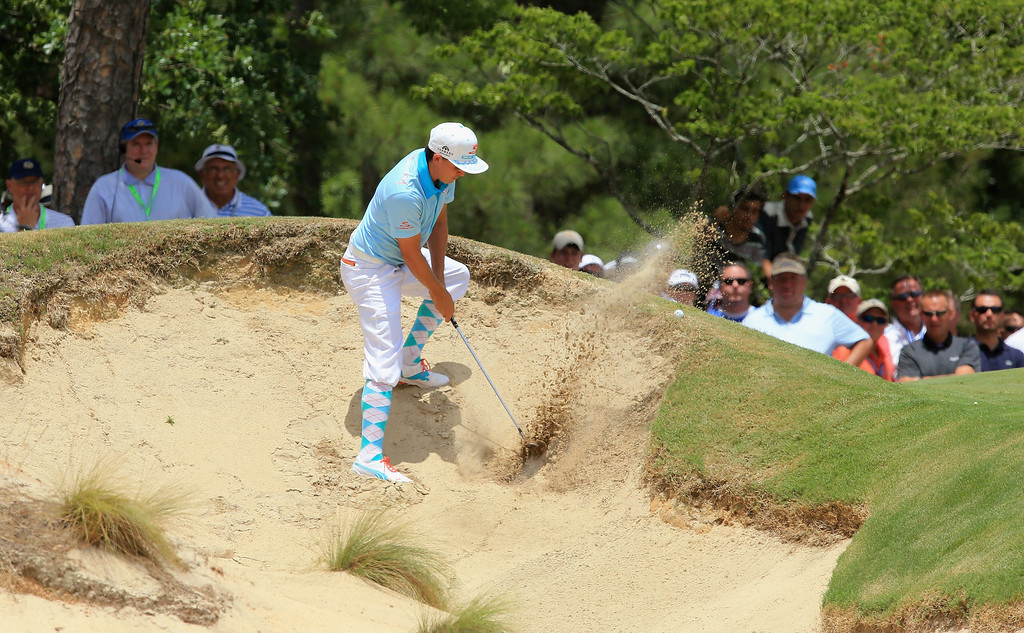 . Rickie Fowler of the United States hits his second shot from a bunker on the ninth hole during the first round of the 114th U.S. Open at Pinehurst Resort & Country Club, Course No. 2 on June 12, 2014 in Pinehurst, North Carolina.  (Photo by David Cannon/Getty Images)