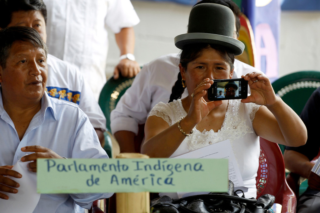 . Bolivia\'s politicians Patricia Mansilla takes video in the indigenous neighborhood of Monimbo in Masaya, Nicaragua, Wednesday, April 10, 2013.  Mansilla is in Nicaragua, along with legislators from Nicaragua, Peru, Bolivia, Chile, Colombia, Ecuador, Guatemala, Honduras, Mexico, Panama and Venezuela,  for the 13th ordinary session of the Indigenous Parliament of America. (AP Photo/Esteban Felix)