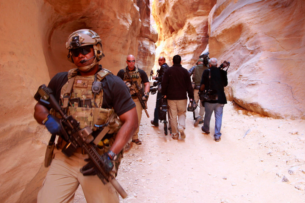 . Members of the U.S. Secret Service Counter Assault Team survey a path after U.S. President Barack Obama walked through it during his tour of the ancient historic and archaeological site of Petra March 23, 2013. Obama visited Jordan\'s ancient city of Petra on Saturday as he wrapped up a four-day Middle East tour by setting aside weighty diplomatic matters and playing tourist for a day. REUTERS/Muhammad Hamed