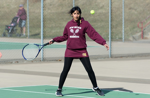 04/02/19 Wesley Bunnell | Staff New Britain girls tennis took on Wilcox Tech in their first matches of the season on Tuesday afternoon. Damya Albosalni in her doubles match.