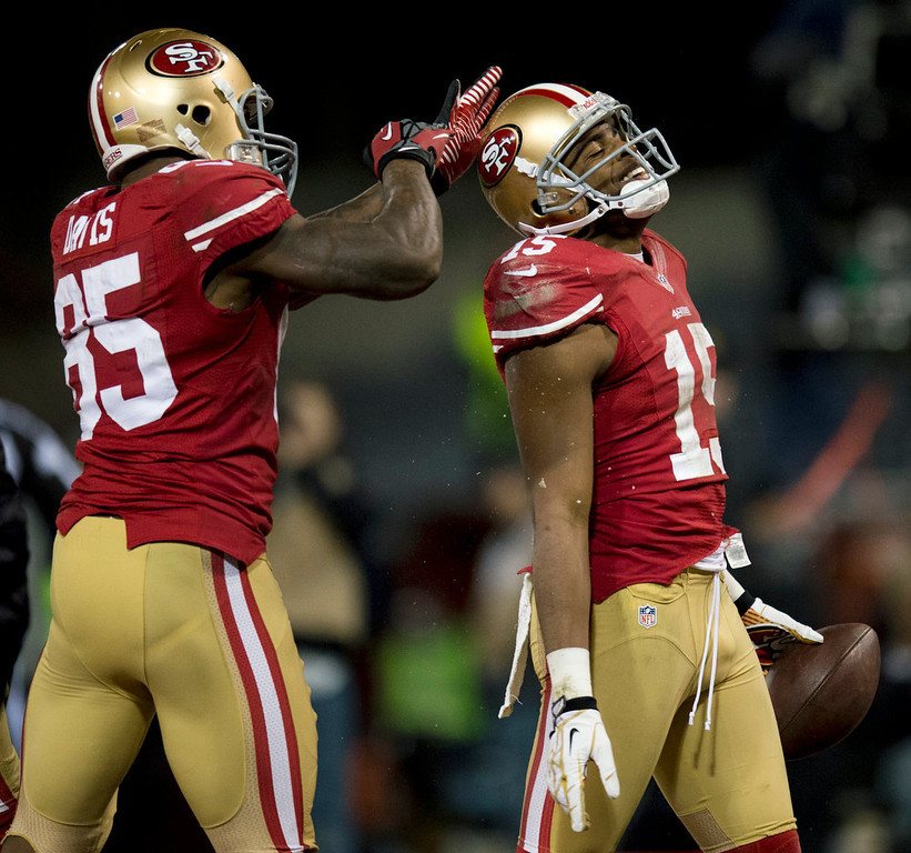 . San Francisco 49ers tight end Vernon Davis (85) celebrates with wide receiver Michael Crabtree (15) after his touchdown in the second quarter during an NFC divisional playoff NFL football game against the Green Bay Packers on Saturday, Jan. 12, 2013, in San Francisco. (AP Photo/The Sacramento Bee, Paul Kitagaki Jr.)