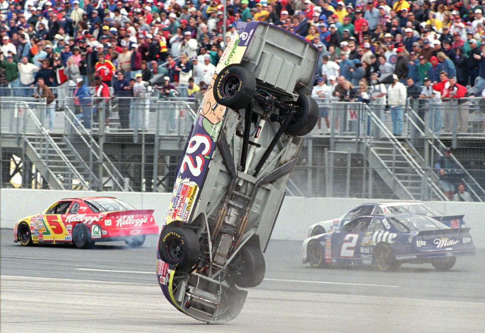 Description of . Robert Pressley, from Ashville, N.C., is upside down as he flips his Chevrolet on the backstretch during the running of the Daytona 500 auto race Sunday, Feb. 16, 1997, in Daytona Beach, Florida. Pressley was not injured in the mishap. (AP Photo/David Mills-The Lakeland Ledger)