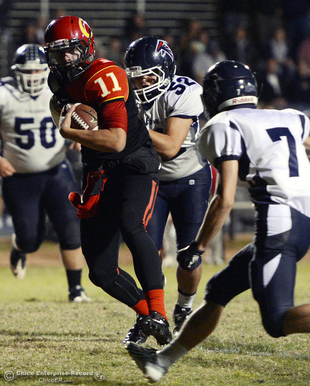. Chico High\'s #11 Clayton Welch (left) rushes against Central Valley High\'s #52 Ernesto Alvarez (center) and #7 James Quinn (right) in the first quarter of their football game at Asgard Yard Friday, September 27, 2013, in Chico, Calif.  (Jason Halley/Chico Enterprise-Record)