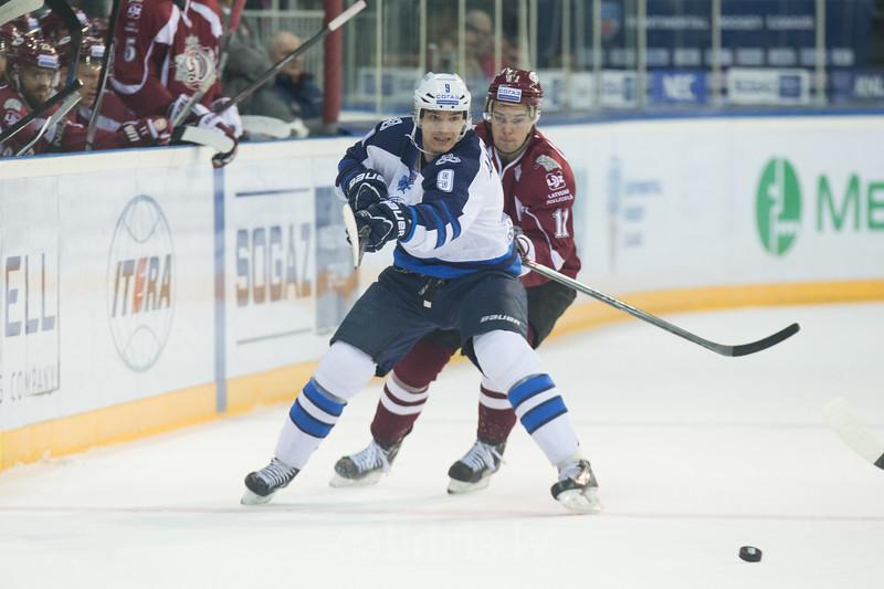 Rafael Akhmetov (9) blocks Kristaps Sotnieks (11) of Dinamo Riga