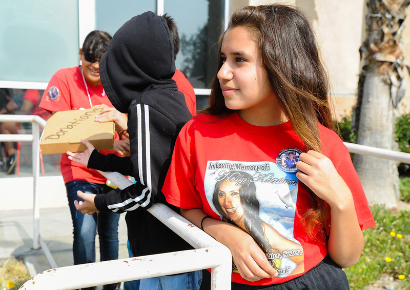. Daughter of slain Domino\'s Pizza shift manager Nelly Kantun, Gema Diaz, 12, works with her cousins to try to get donations during a memorial fundraiser for her mother at Domino\'s Pizza on Highland Avenue in San Bernardino, CA on Wednesday, Feb. 19, 2014. Kantun worked as a Domino\'s employee for more than 20 years, and the pizza location she worked at donated 100 percent of the proceeds earned Wednesday to the memorial fund. (Photo by Rachel Luna / San Bernardino Sun)