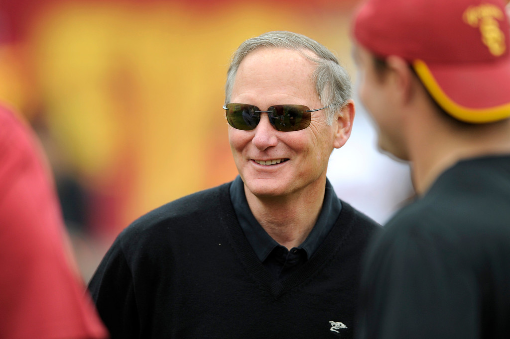 . Athletic director Pat Haden talks with people on the sidelines at USC\'s Spring Football Game. (Michael Owen Baker/Staff Photographer)