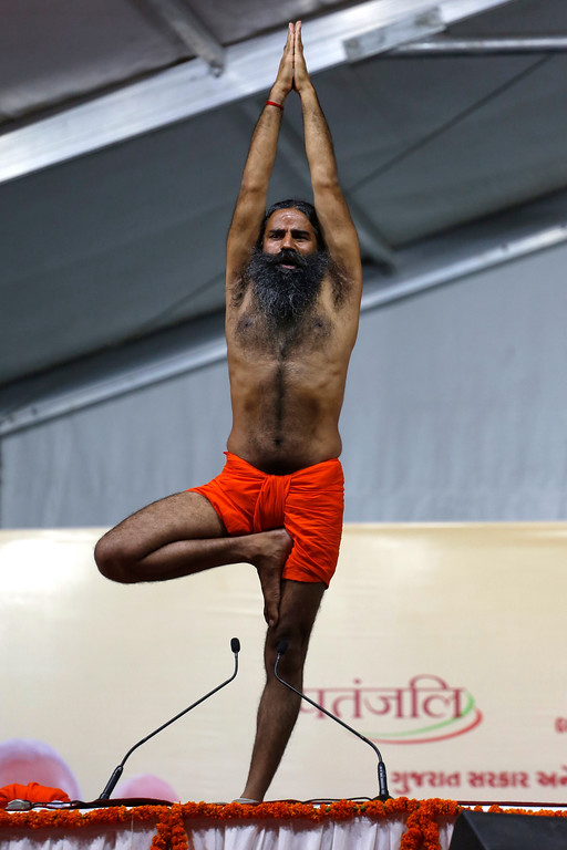 . Yoga guru Baba Ramdev performs Yoga during International Yoga Day celebrations in Ahmadabad, India, Wednesday, June 21, 2017. Millions of yoga enthusiasts across India take part in a mass yoga sessions to mark the third International Yoga Day which falls on June 21 every year. (AP Photo/Ajit Solanki)