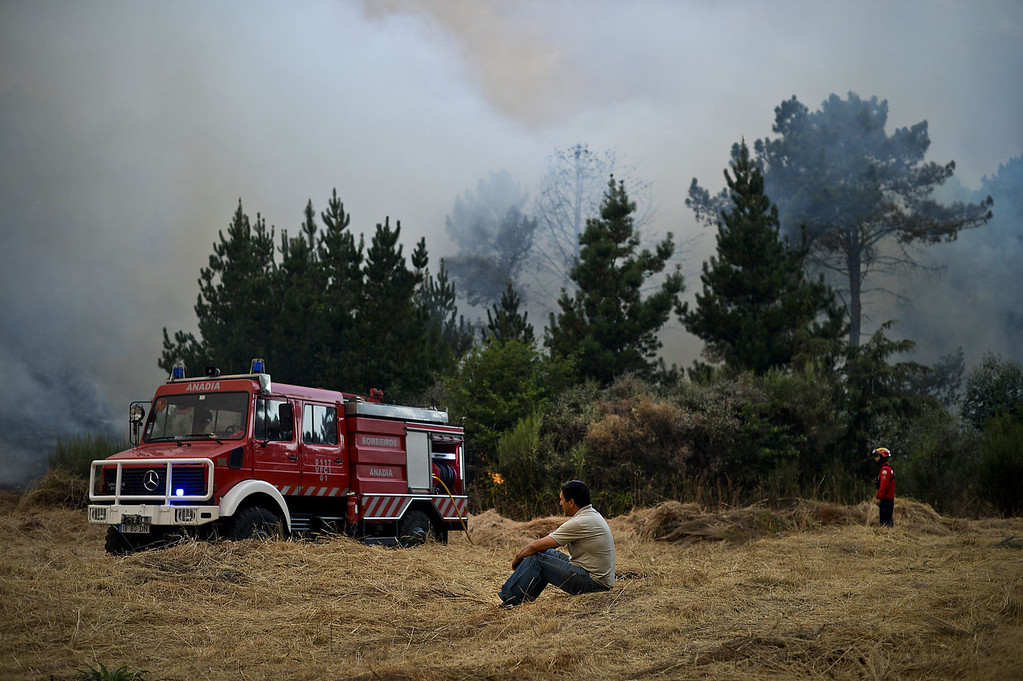 . A firetruck is parked as locals and firefighters battle a wildfire in Caramulo, central Portugal on August 29, 2013. Five Portuguese mountain villages were evacuated overnight as forest fires intensified in the country\'s north and centre, officials said today. As many as 1,400 firefighters were dispatched Thursday to tackle the blaze in the mountains and another raging further north in the national park of Alvao, where 2,000 hectares (4,900 acres) of pine forest have already been destroyed, according to the local mayor.   PATRICIA DE MELO MOREIRA/AFP/Getty Images