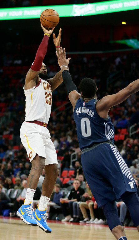 . Cleveland Cavaliers forward LeBron James (23) takes a shot against Detroit Pistons center Andre Drummond (0) during the second half of an NBA basketball game Tuesday, Jan. 30, 2018, in Detroit. The Pistons defeated the Cavaliers 125-114. (AP Photo/Duane Burleson)