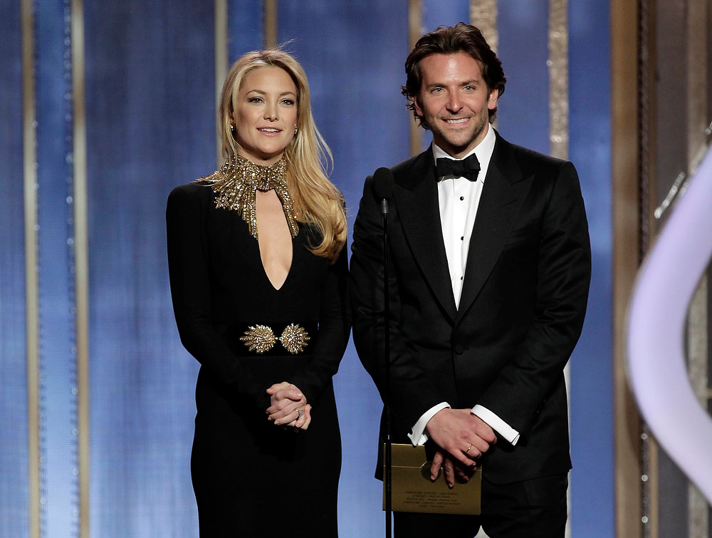 Description of . This image released by NBC shows presenters Kate Hudson, left, and Bradley Cooper on stage during the 70th Annual Golden Globe Awards at the Beverly Hilton Hotel on Sunday, Jan. 13, 2013, in Beverly Hills, Calif. (AP Photo/NBC, Paul Drinkwater)