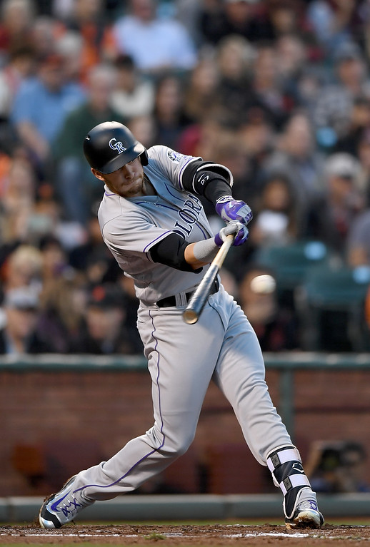 . SAN FRANCISCO, CA - MAY 05:  Trevor Story #27 of the Colorado Rockies hits an RBI single scoring DJ LeMahieu #9 against the San Francisco Giants in the top of the second inning at AT&T Park on May 5, 2016 in San Francisco, California.  (Photo by Thearon W. Henderson/Getty Images)