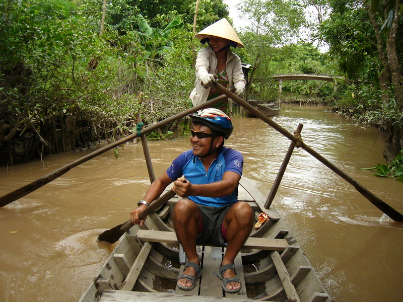 Paddling along a canal at the Mekong Delta