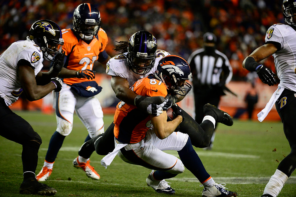 Description of . Denver Broncos wide receiver Eric Decker (87) gets taken down by Baltimore Ravens inside linebacker Dannell Ellerbe (59) in the fourth quarter. The Denver Broncos vs Baltimore Ravens AFC Divisional playoff game at Sports Authority Field Saturday January 12, 2013. (Photo by AAron  Ontiveroz,/The Denver Post)