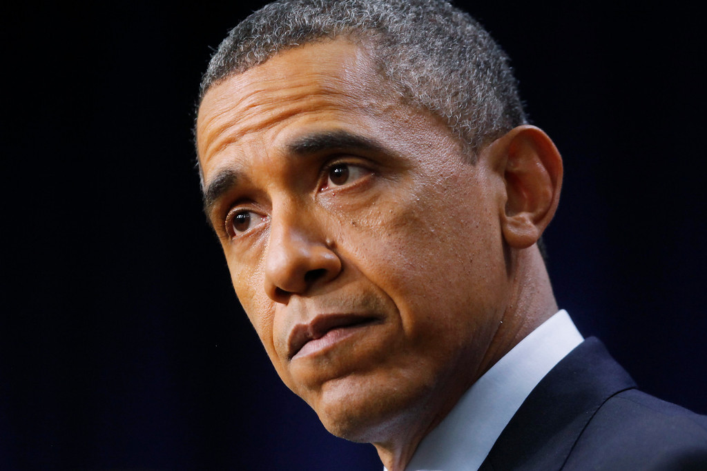 """. President Barack Obama pauses as he speaks about the fiscal cliff, Monday, Dec. 31, 2012, in the South Court Auditorium at the White House in Washington. The president said it appears that an agreement to avoid the fiscal cliff is \""""in sight,\"""" but says it\'s not yet complete and work continues.  (AP Photo/Charles Dharapak)"""