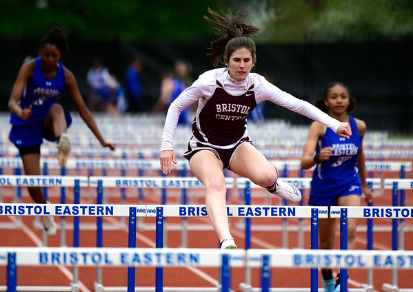 5/14/2019 Mike Orazzi | Staff Bristol Central's Christine Attle in the 100 hurdles during Tuesday's city track meet at Eastern.