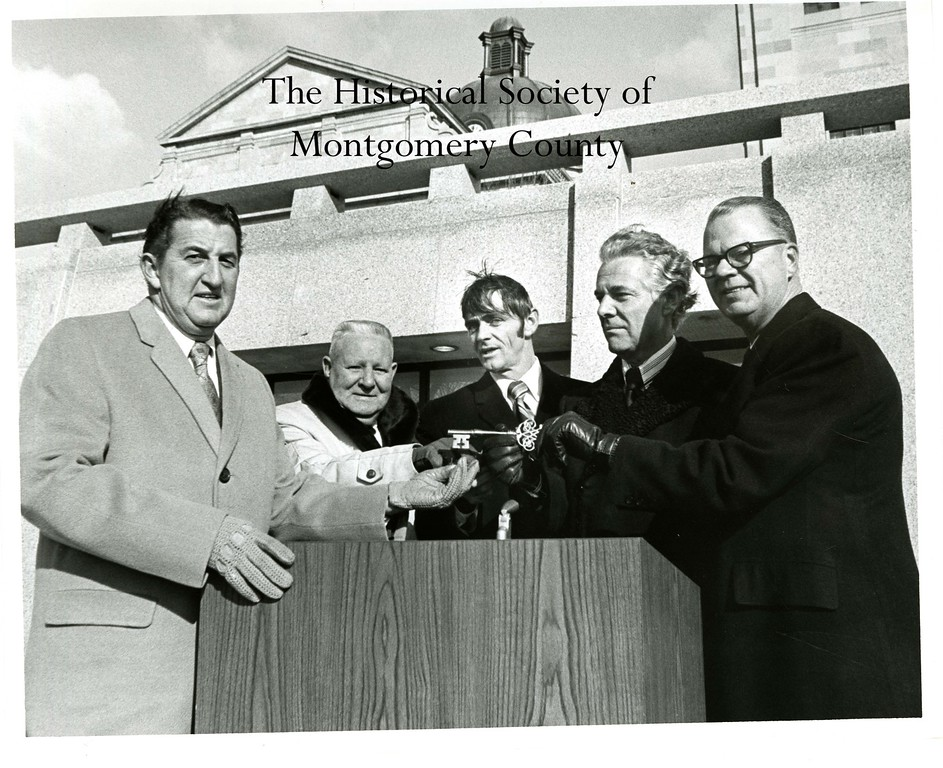 . This photo from the Historical Society of Montgomery County shows the dedication of the Montgomery County Courthouse in 1971.  Pictured from left is County Commissioners Frank W. Jenkins, David T. Costello, President of Van Cor James W. Hughes Jr., Vincent G. Kling (from the architectural firm that designed the annex) and Commissioners\' Chairman A. Russell Parkhouse.