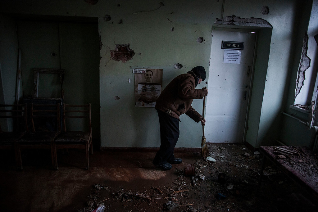 . A woman sweeps up the debris in  Hospital N� 3,  after it was hit by Ukrainian Army artillery in Kalininsky district, in Donetsk, Ukraine. Monday, Jan. 19, 2015. The separatist stronghold, Donetsk, was shaken by intense outgoing and incoming artillery fire on Sunday as a bitter battle raged for control over the city\'s airport. Streets in the city, which was home to 1 million people before unrest erupted in spring, were completely deserted and the windows of apartments in the center rattled from incessant rocket and mortar fire.  (AP Photo/Manu Brabo)