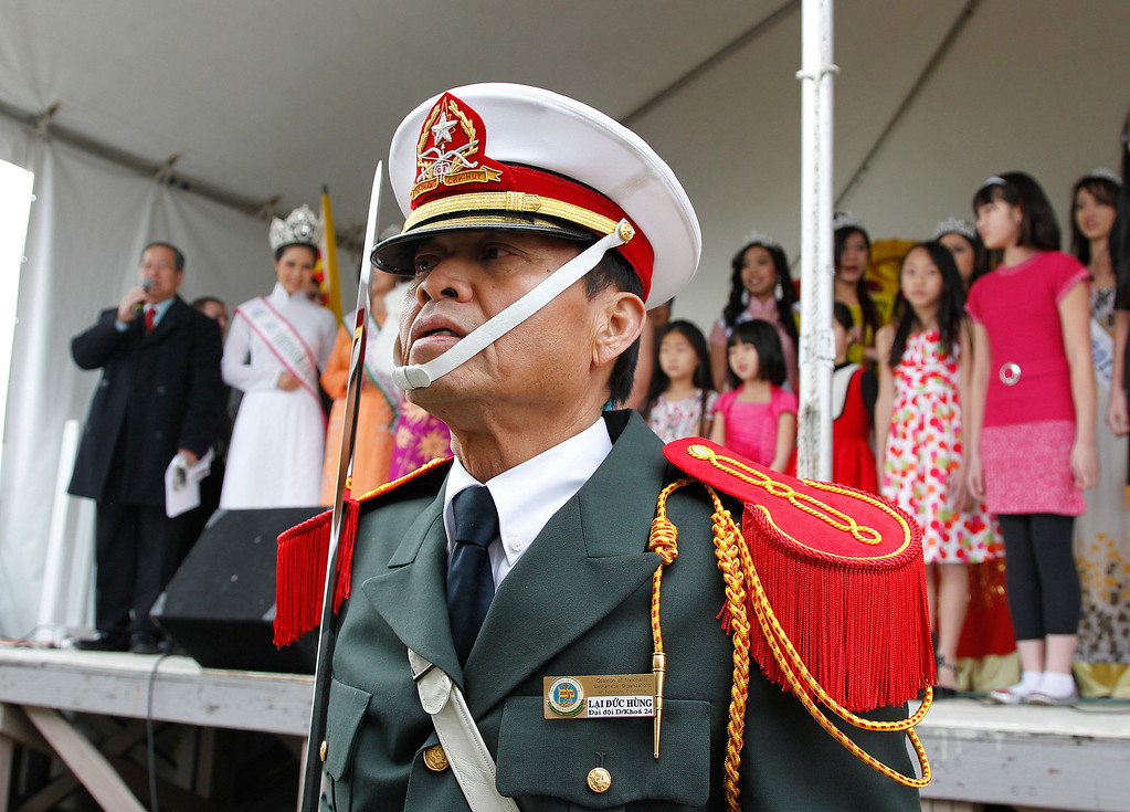 . Hung Lai, General Secretary of the Coalition of Nationalist Vietnamese Organizations of Northern California (CONVONCA) stands at attention during the praying ceremony at the Tet festival hosted by CONVONCA at the Santa Clara County Fairgrounds in San Jose, Calif. on Saturday, February 2, 2013. Lai wears a uniform from when he attended the Vietnamese National Military Academy in 1967. (LiPo Ching/Staff)