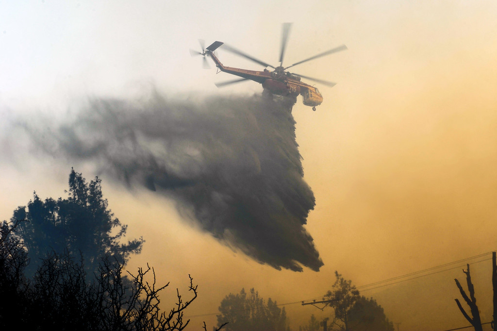 . A sky crane makes a drop on the Powerhouse Fire along Pine Canyon Road in Lake Hughes, Sunday, June 2, 2013. (Michael Owen Baker/Staff Photographer)