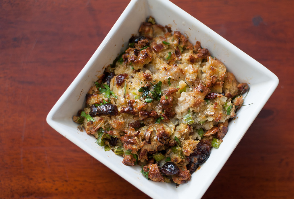 ". Cranberry pecan stuffing is shown at the Market on Main in downtown Mt. Pleasant. Emma Currie said, ""The addition of pecans and dried cranberries add a crunch and some nice fruity tanginess to the stuffing. I opted for dried cranberries over dried cherries because they are more affordable, and the tartness works in this savory stuffing.\"" (Sun photo by Holly Mahaffey/@hollymahaffey)"