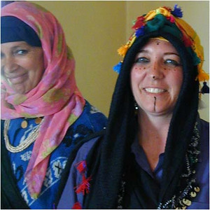 In this photo, the Moroccan lady (left) has just applied the traditional wedding make-up to the woman on the right. We discovered later that the make-up is semi-permanent. It took almost a week before it all faded despite numerous attempts to wash it off.