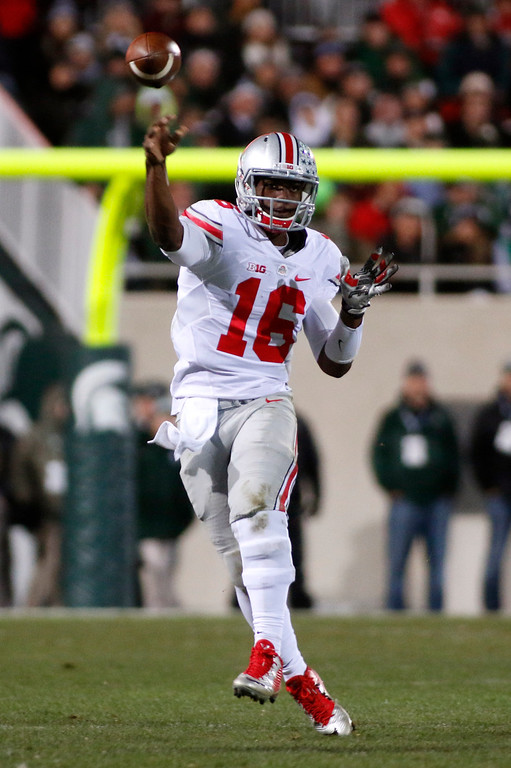 . Ohio State quarterback J.T. Barrett throws a pass during the second quarter of an NCAA college football game against Michigan State, Saturday, Nov. 8, 2014, in East Lansing, Mich. Ohio State won 49-37. (AP Photo/Al Goldis)