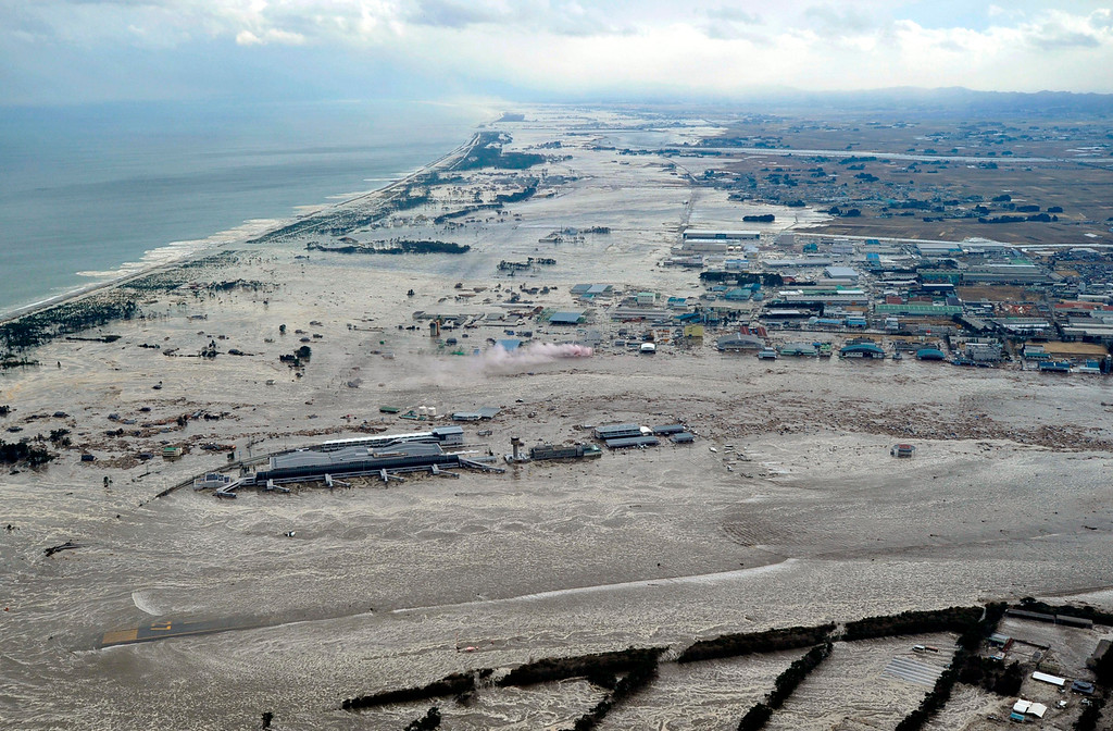 . Earthquake-triggered tsunami sweeps the shore as Sendai Airport is surrounded by waters in Miyagi prefecture (state), Japan, Friday, March 11, 2011. The ferocious tsunami spawned by one of the largest earthquakes ever recorded slammed Japan\'s eastern coasts. (AP Photo/Kyodo News)