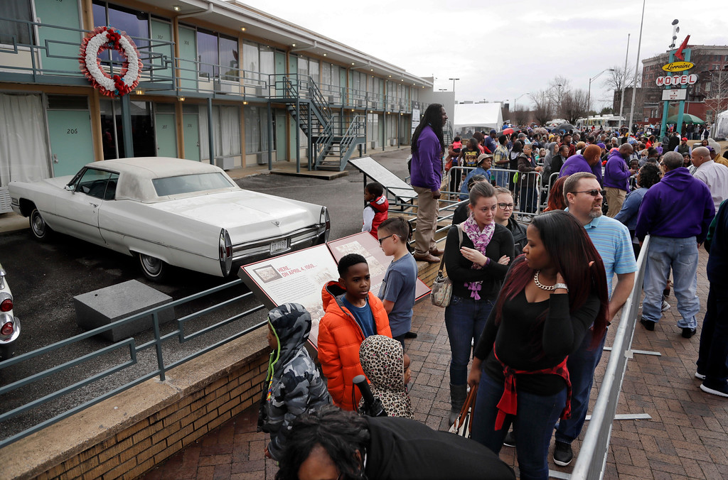 . People wait in line to enter the National Civil Rights Museum on Martin Luther King Jr. Day, Monday, Jan. 16, 2017, in Memphis, Tenn. The museum is built in what was formerly the Lorraine Motel, and the balcony at upper left is marked with a wreath where King was assassinated on April 4, 1968. (AP Photo/Mark Humphrey)