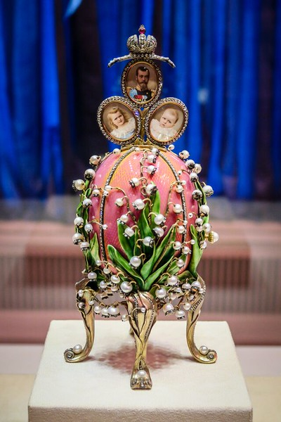 A pink and green ornate egg is displayed in Faberge Museum, St Petersburg