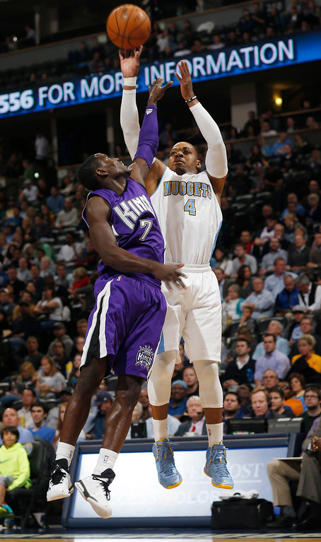 . Sacramento Kings guard Darren Collison, front, defends against a shot by Denver Nuggets guard Randy Foye in the third quarter of the Kings\' 110-105 victory in an NBA basketball game in Denver on Monday, Nov. 3, 2014. (AP Photo/David Zalubowski)