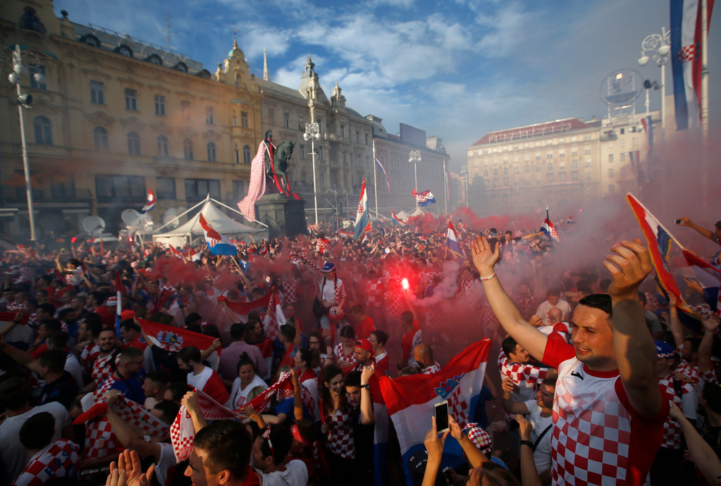 . Croatia soccer fans shout chants and cheer as they watch a television broadcast of the Russia 2018 World Cup match between France and Croatia in downtown Zagreb, Croatia, Sunday, July 15, 2018. (AP Photo/Darko Vojinovic)