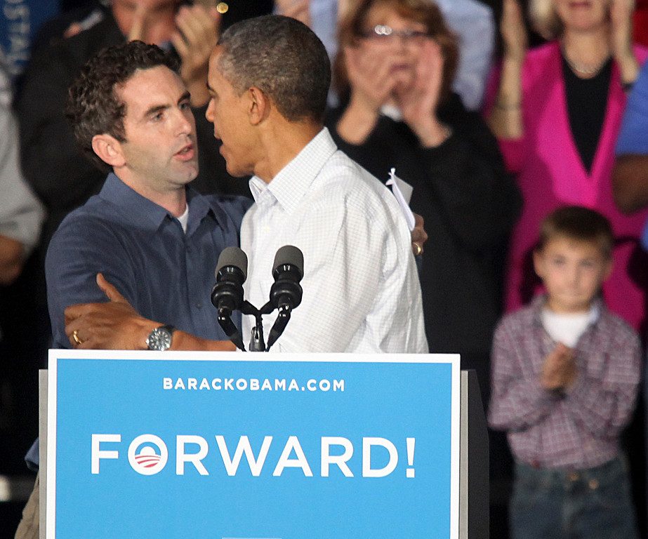 . Kevin Potter of Kirtland embraces President Barack Obama after Potter introduced Obama at a November 2012 rally at Mentor High School. Potter shared a personal story about health care surrounding his daughter Erin who suffers from Leukemia. (News-Herald file)