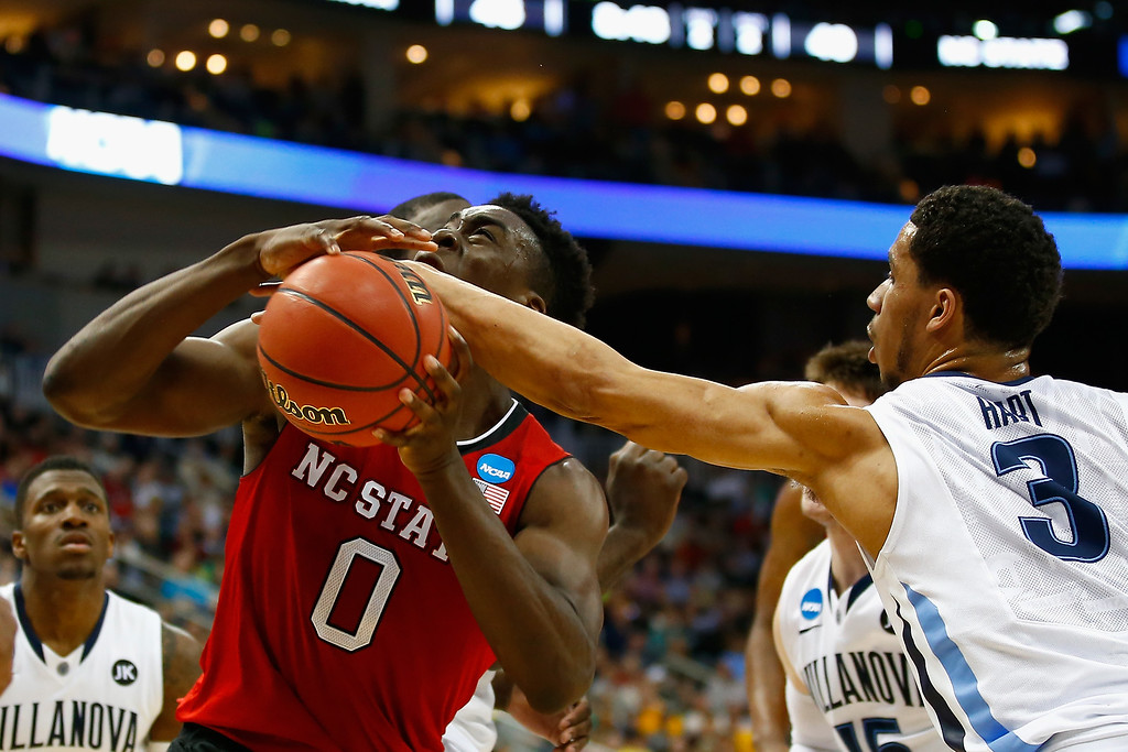 . Josh Hart #3 of the Villanova Wildcats tries to strip the ball from Abdul-Malik Abu #0 of the North Carolina State Wolfpack in the second half during the third round of the 2015 NCAA Men\'s Basketball Tournament at Consol Energy Center on March 21, 2015 in Pittsburgh, Pennsylvania.  (Photo by Jared Wickerham/Getty Images)