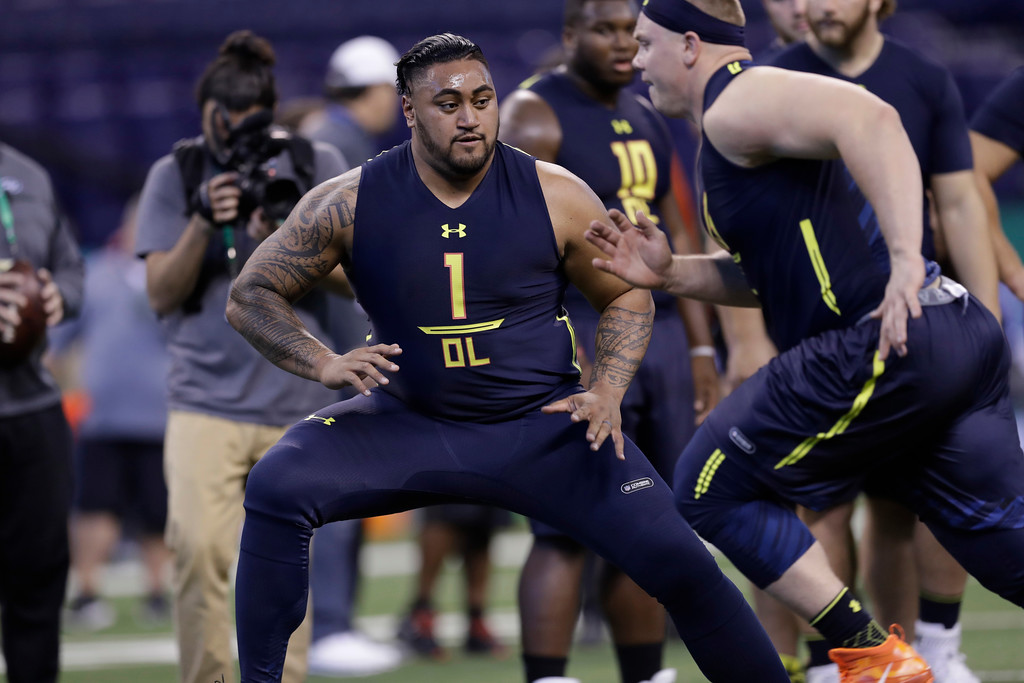 . Utah offensive lineman Isaac Asiata runs a drill at the NFL football scouting combine Friday, March 3, 2017, in Indianapolis. (AP Photo/David J. Phillip)