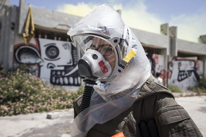 """. A soldier of the Israeli home front brigade during a drill of a chemical attack over a building with multiple casualties during the Home Front drill \""""Turning Point 7\"""" on May 28, 2013 in Azur, Israel. The nationwide exercise tests the civilian population\'s response to a possible massive rocket attack from three fronts. (Photo by Ilia Yefimovich/Getty Images)"""