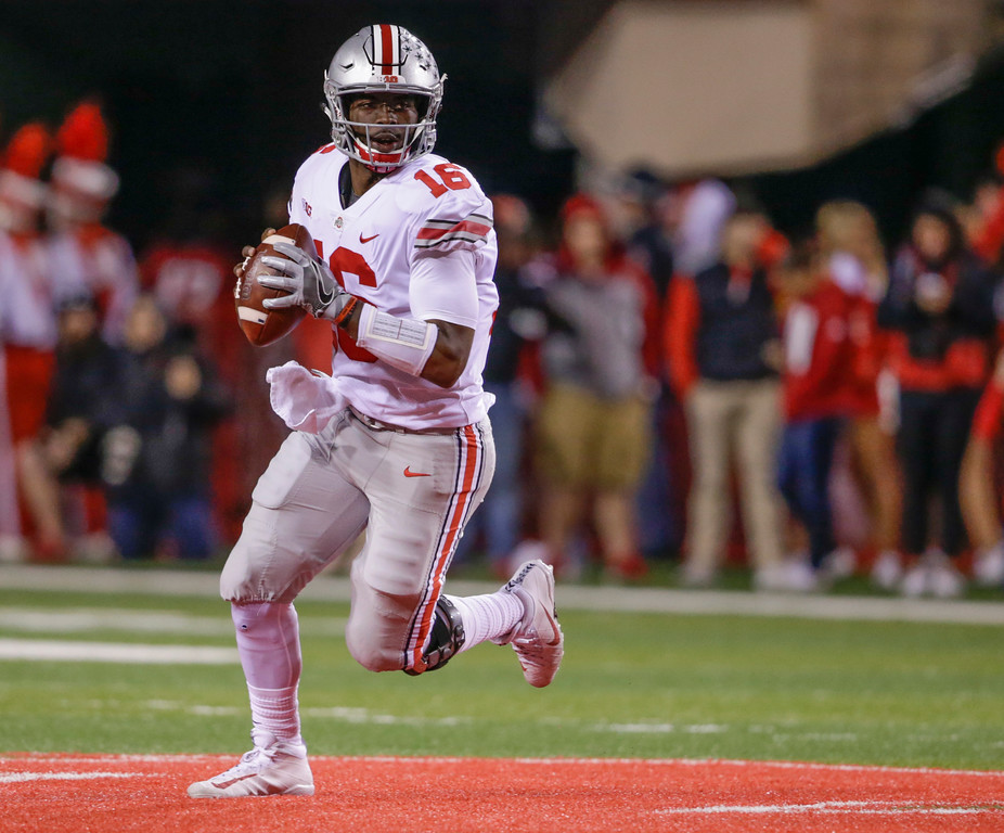 . Ohio State quarterback J.T. Barrett looks for a receiver during the first half of an NCAA college football game against Nebraska in Lincoln, Neb., Saturday, Oct. 14, 2017. Barrett passed for five touchdowns and ran for two others as Ohio State won 56-14. (AP Photo/Nati Harnik)
