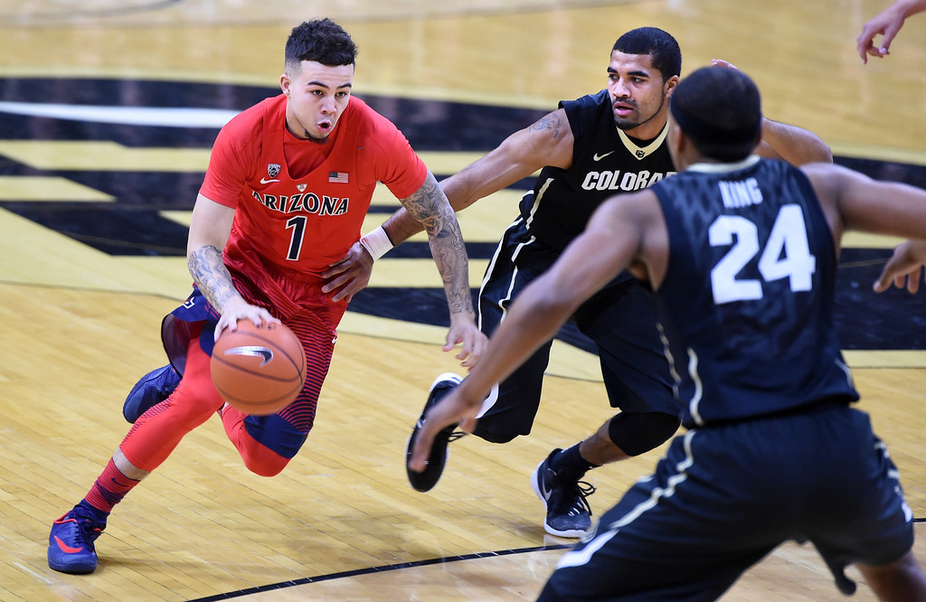 . Arizona guard Gabe York drives Colorado\'s Xavier Talton and George King, of Colorado (24) during the first half of an NCAA college basketball game Wednesday, Feb. 24, 2016, in Boulder, Colo. (AP Photo/Cliff Grassmick)