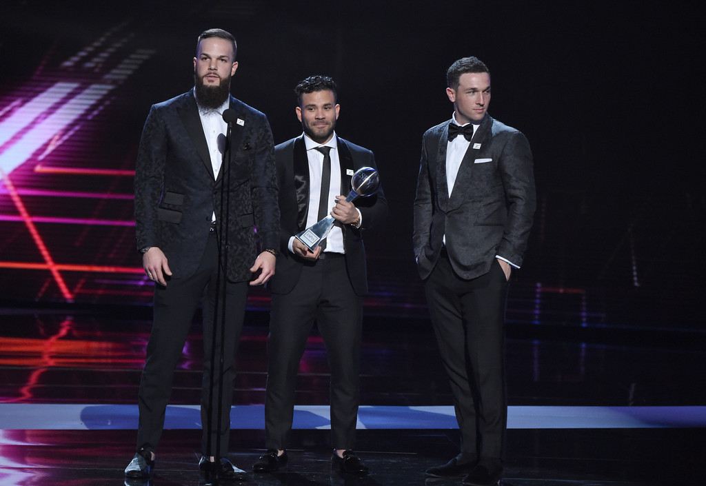. Houston Astros\' Dallas Keuchel, Jose Altuve and Alex Bregman, from left, accept the award for best team, at the ESPY Awards at Microsoft Theater on Wednesday, July 18, 2018, in Los Angeles. (Photo by Phil McCarten/Invision/AP)