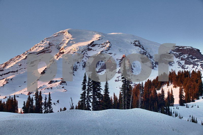 The start of alpine glow on Mt. Rainier on a winter day as seen from the paradise Visitor Center.