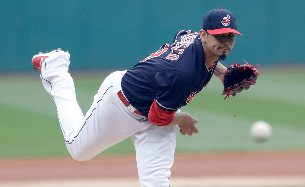 . Cleveland Indians starting pitcher Carlos Carrasco delivers in the first inning of a baseball game against the Seattle Mariners, Saturday, April 28, 2018, in Cleveland. (AP Photo/Tony Dejak)