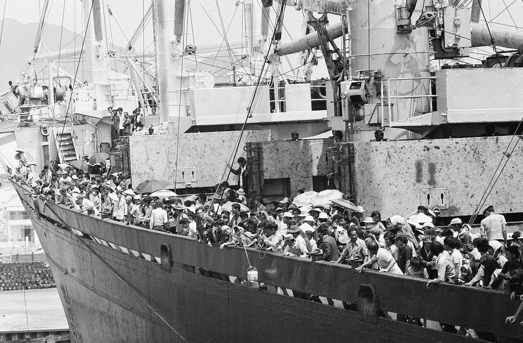 . Teeming frightened humanity crowds the decks of the merchant vassal Pioneer Contender as it docks at Cam Ranh Bay on the central coast of South Vietnam, Friday, March 29, 1975. Ship carried 5,600 South Vietnamese refugees and about 40 Americans out of Danang, a refugee crammed city under the gun. (AP Photo/Huynh Cong/Ut)