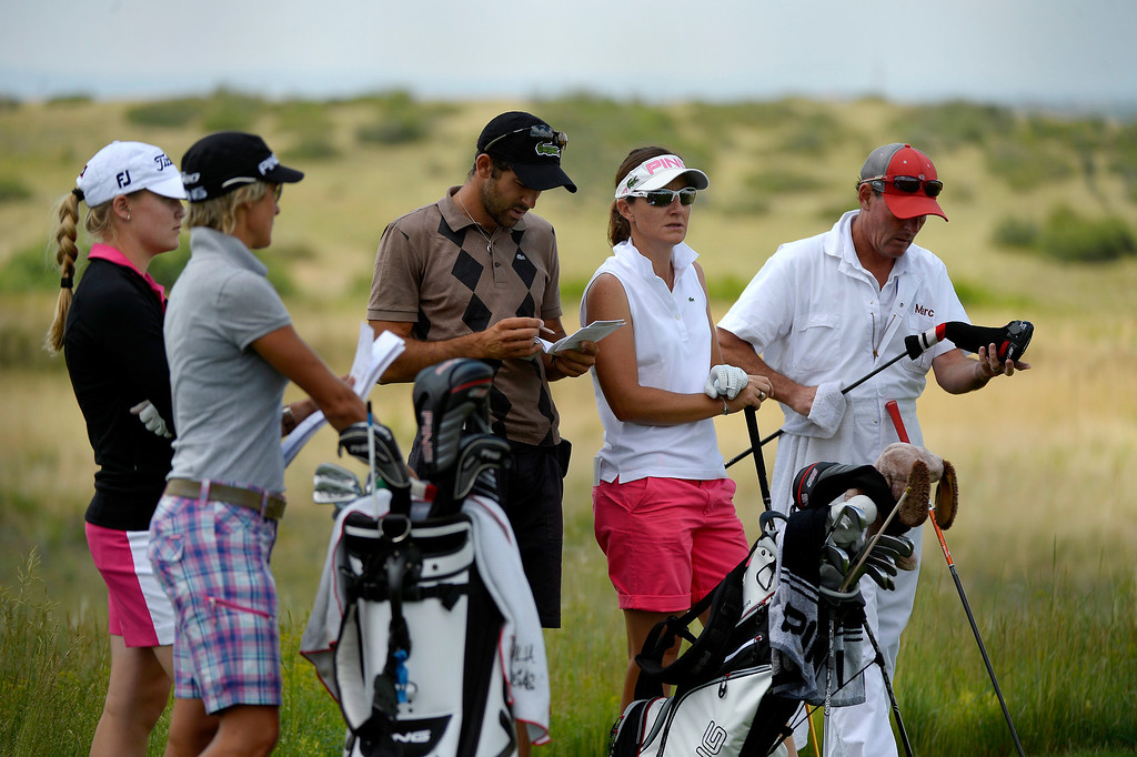 . Charley Hull of England (left) and Gwladys Nocera of France (3rd from left) watch the drive of Giulia Sergas of Italy as they wait for their turn during practice with the 2013 European Solheim Cup Team.  (Photo By Joe Amon/The Denver Post)