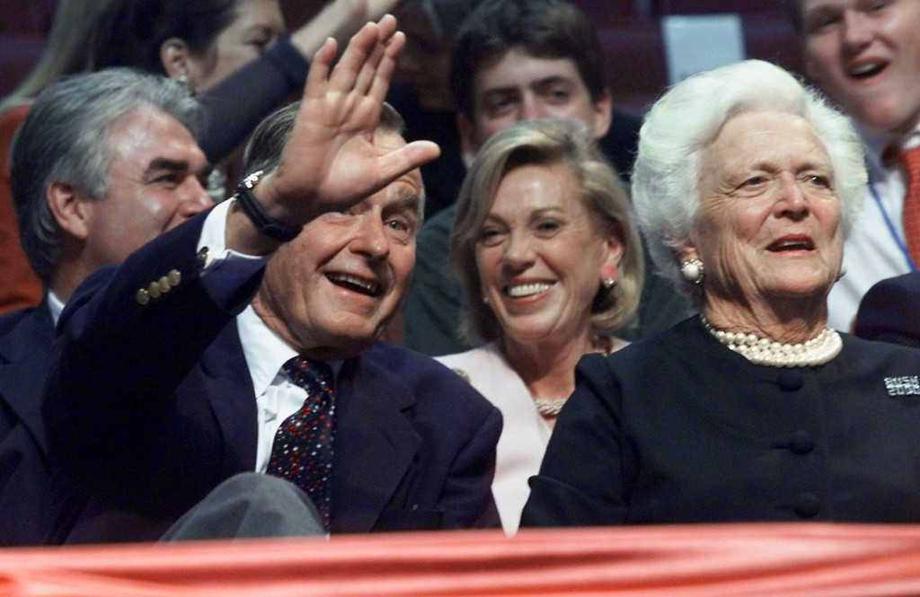 . Former President George Bush waves after he and wife Barbara arrive at the Republican National Convention in Philadelphia on Monday, July 31, 2000. (AP Photo/Hillery Smith Garrison)
