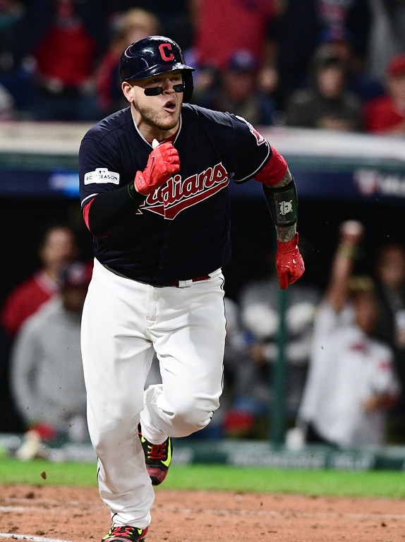 . Cleveland Indians\' Roberto Perez watches his RBI single off New York Yankees starting pitcher CC Sabathia during the fifth inning of Game 5 of a baseball American League Division Series, Wednesday, Oct. 11, 2017, in Cleveland. (AP Photo/David Dermer)