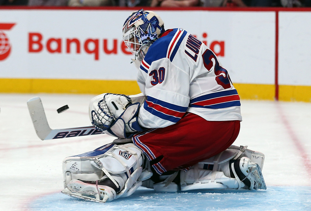 . Henrik Lundqvist #30 of the New York Rangers makes a save against the Montreal Canadiens during the third period in Game Two of the Eastern Conference Final during the 2014 Stanley Cup Playoffs at Bell Centre on May 19, 2014 in Montreal, Canada.  (Photo by Bruce Bennett/Getty Images)